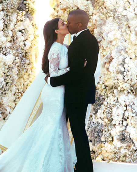 1401203092_Kim-Kardashian-and-Kanye-West-wedding-snaps-matching-jackets-valentino-kissing